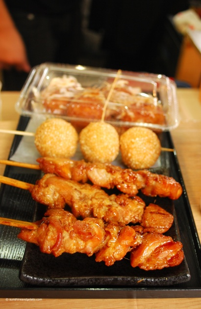 Lunch in Arahiyama - chicken yakitori, goma dango (fried glutinous rice flour balls) and takoyaki.