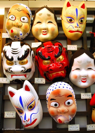 The streets around Senso-ji are filled with shops selling incence sticks, delicious snacks and traditional masks like these.
