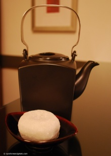 Winding down after a hard day's sightseeing with some tea and daifuku that I purchased from a stall outside Senso-ji. Daifuku are glutinous rice balls filled with sweetened red bean paste.