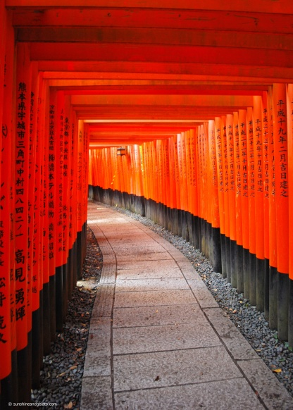 The inner shrine is located on the mountain behind the main shrine. The path into the mountain is lined by thousands of vermillion torii gates.