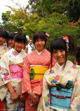 Girls dressed in kimonos visiting Kinkaku-ji