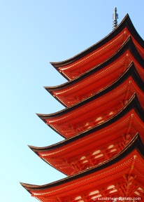 The brilliant vermillion facade of Goju-no-to pagoda, inside the Itsukushima Shrine complex.
